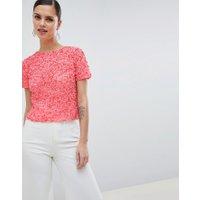 ASOS DESIGN - T-shirt med paljetter - Korallorange