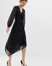 Warehouse - svart glittrig midiklänning med snurrad knut framtill och  asymmetrisk fåll - Svart b42fa21b40f0e