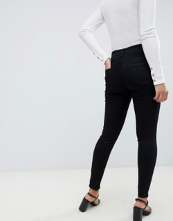 ASOS DESIGN Maternity high rise ridley 'skinny' jeans in clean black with under the bump waistband