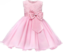 Festklänning med rosett och blommor - rosa