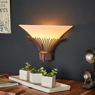 Vägglampan Canna med afrikansk touch