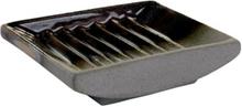 Tvålkopp Cube mineral från Cult design. Färg: Grå med brända bruna,vita och blå stänk.
