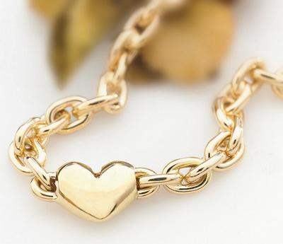 Armlenke med hjerte i gull