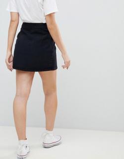 ASOS DESIGN Petite denim wrap skirt in washed black