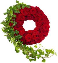 Begravelseskrans med røde roser