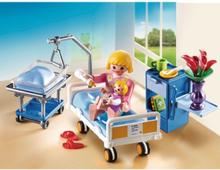 - City Life - Förlossningsrum med spjälsäng