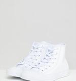 00e74f3049ae12 Asos. Converse - Chuck Taylor - Vita höga sneakers i skinn - Vit