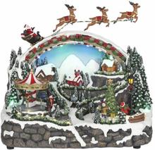 Julelandskap med karusell, nisse og slede - juleby Luville