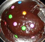 eggless chocolate cake in pressure cooker with icing